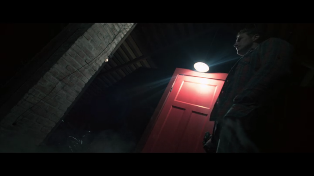 Canted angles and bright red door in Insidious