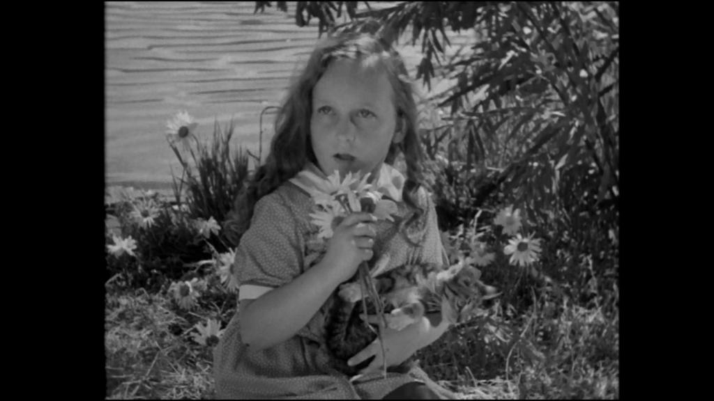 Little girl sat outside in Frankenstein