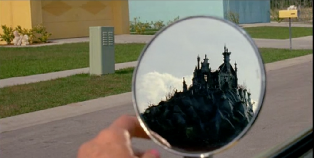 The inventor's home reflected in the car mirror in Edward Scissorhands