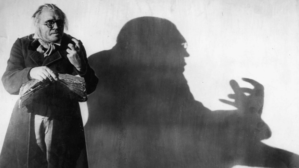 Dr, Caligari with a sinister shadow on the wall