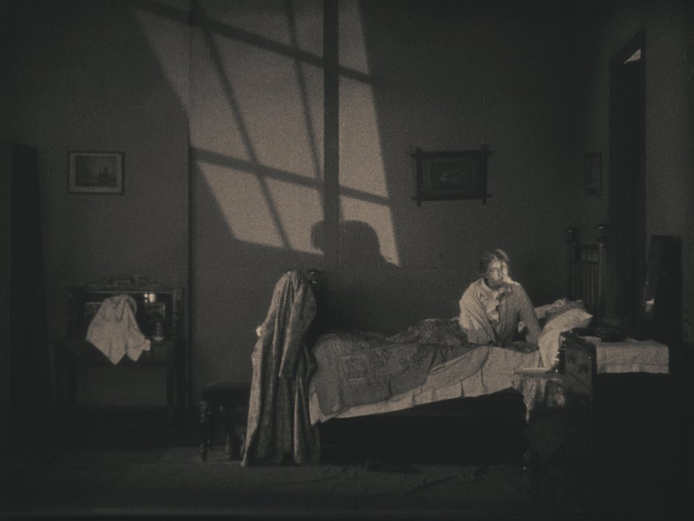Shadows on the wall in The Lodger