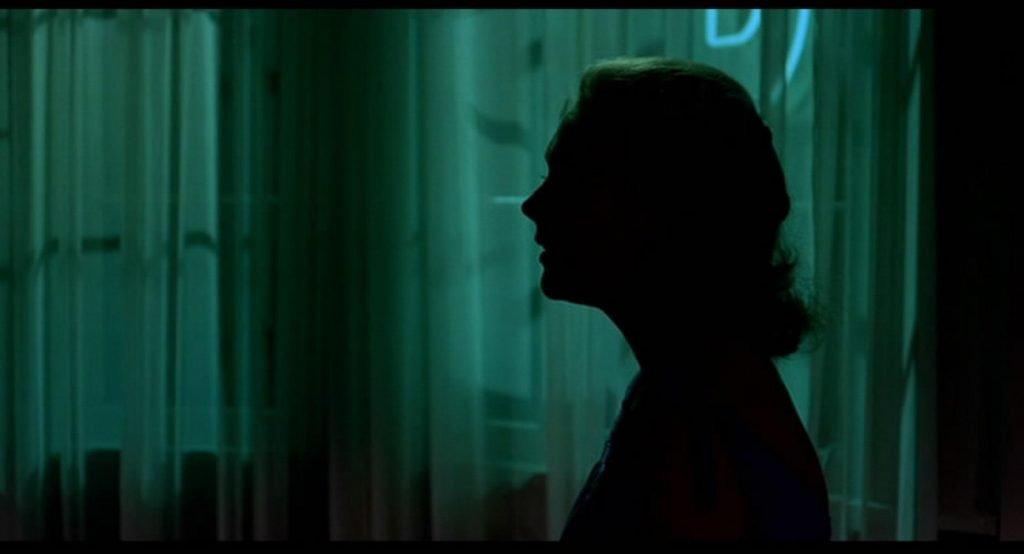 The face of Madeline/Judy in Vertigo covered in shadow