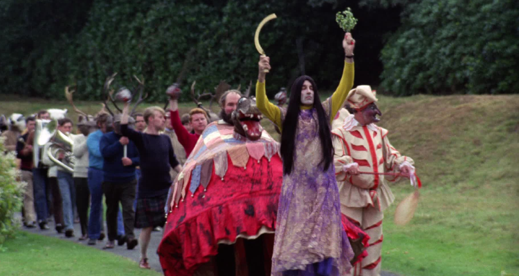 Still of the villagers parading in The Wicker Man