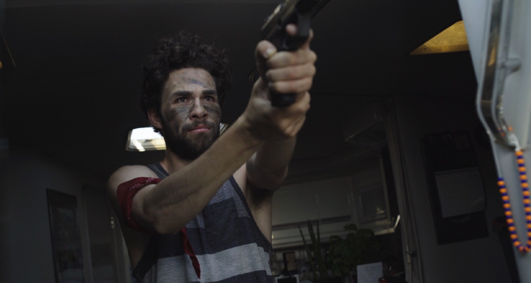 Still from The Cove - Cairo pointing his gun.
