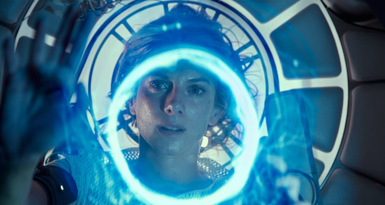 Mélanie Laurent looking at a bright blue light in Oxygen.