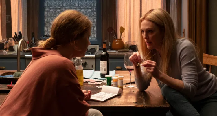 Amy Adams and Julianne Moore chat over wine in The Woman in the Window.