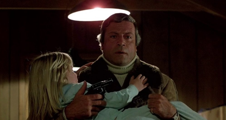 Dr Raglan carrying Candice in The Brood.