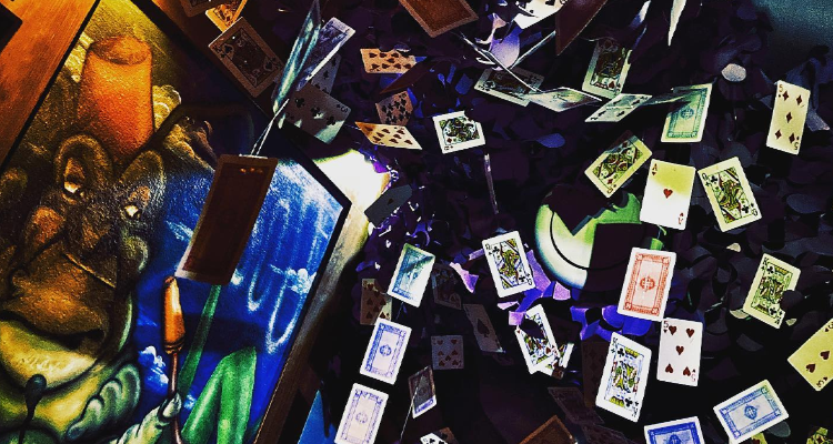 A room full of flying playing cards in Escape from Wonderland.