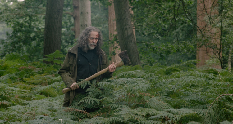 Reece Shearsmith in the woods with an axe - still from In the Earth