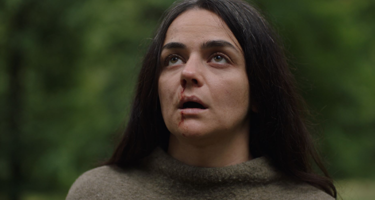 Haley Squires looking up fearfully - still from In the Earth