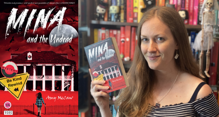 Author Amy McCaw holding up a copy of her book, Mina and the Undead.