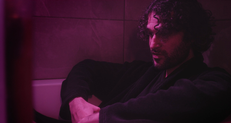 Daniel Hayde sitting in the bath in Perpetual