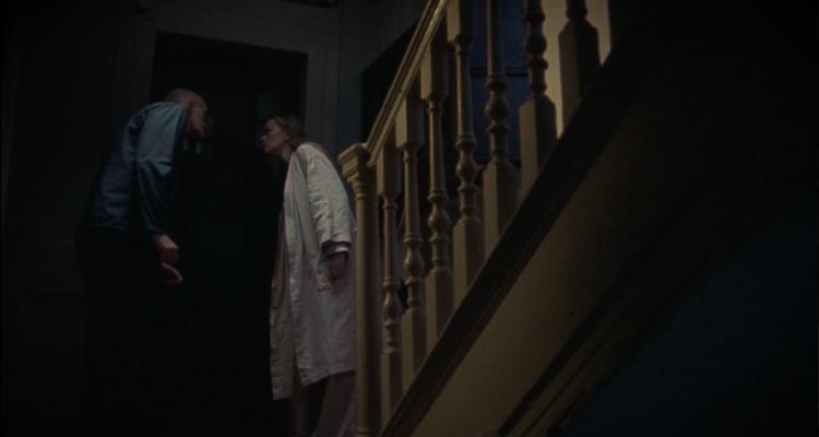 The couple listening in through the door.