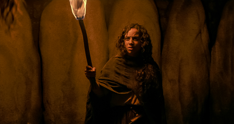 Sarah Fier holding up a torch in Fear Street: 1666
