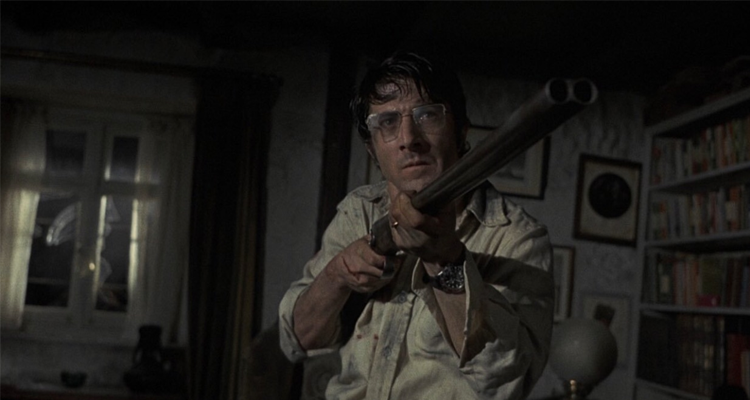 David pointing a double-barreled shotgun.
