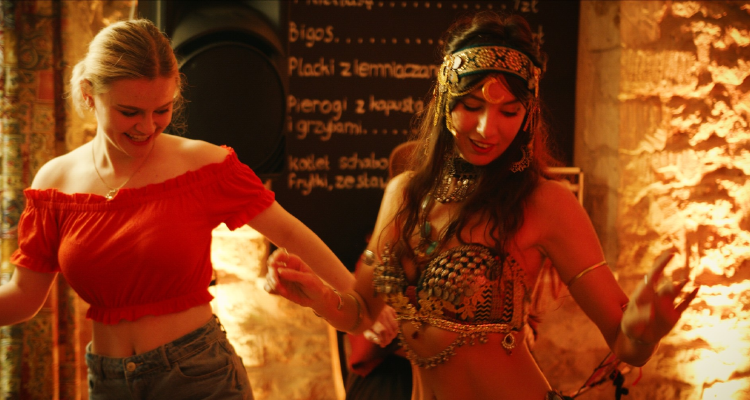 Hannah dancing with the belly dancer in The Suppression of Hannah Stevenson