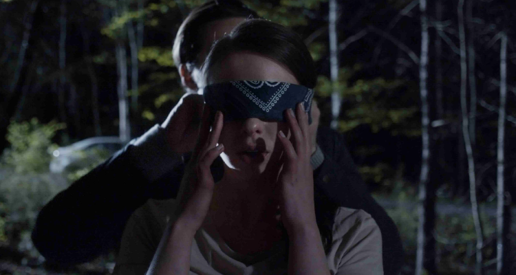 Jamie blindfolding Ava in An Unquiet Grave