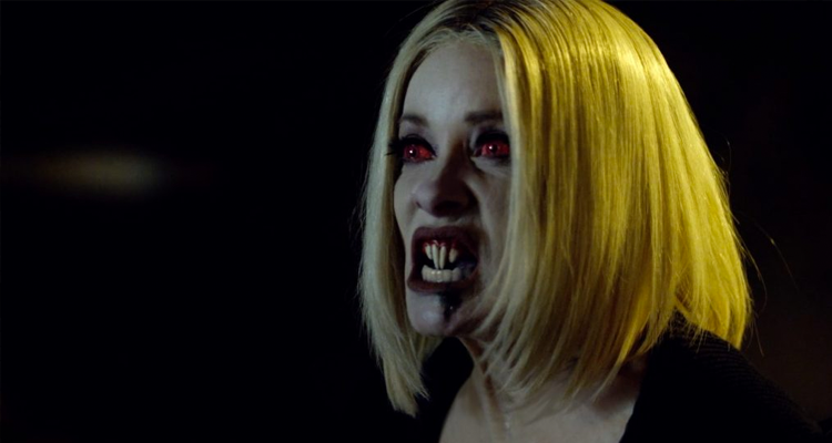Barbra Crampton as Jakob's Wife with red eyes and sharp teeth.