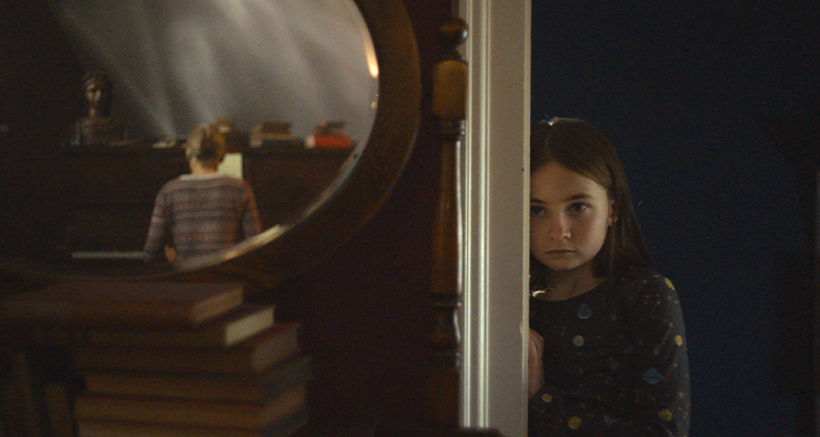 Young girl watching her mom play the piano. Still from Martyrs Lane.
