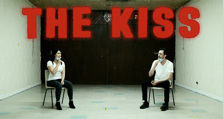 Promo shot for the kiss. A man and a woman sitting far away from each other with masks on.