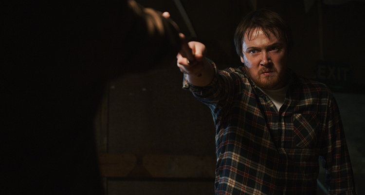 Ed Hartland holding up a knife. Still from When the Screaming Starts.