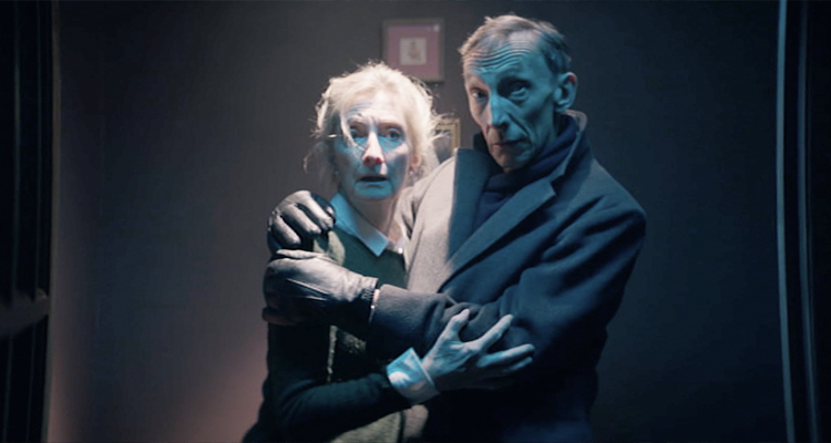Julian Richings holding on to Shelia McCarthy in Anything for Jackson.