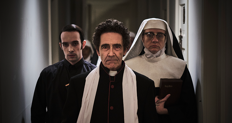 Two priests and a nun walk down a hall. Still from Agnes.