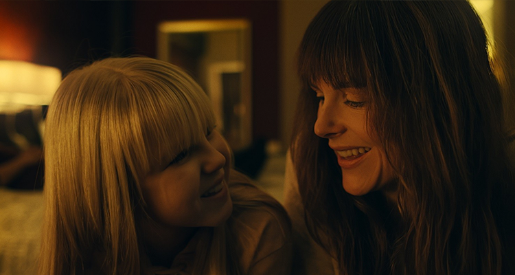 A mother and daughter laugh happily. Still from Hall.