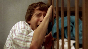 The Baby crying against his crib.