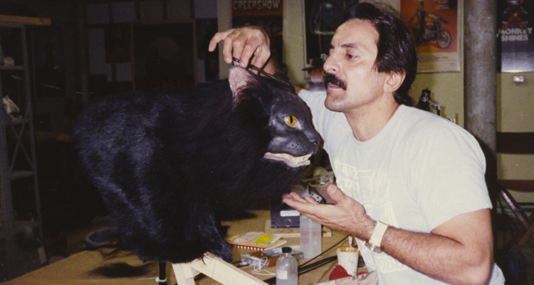 Tom Savini cutting the fur of a black cat puppet. Still from Smoke and Mirrors documentary.