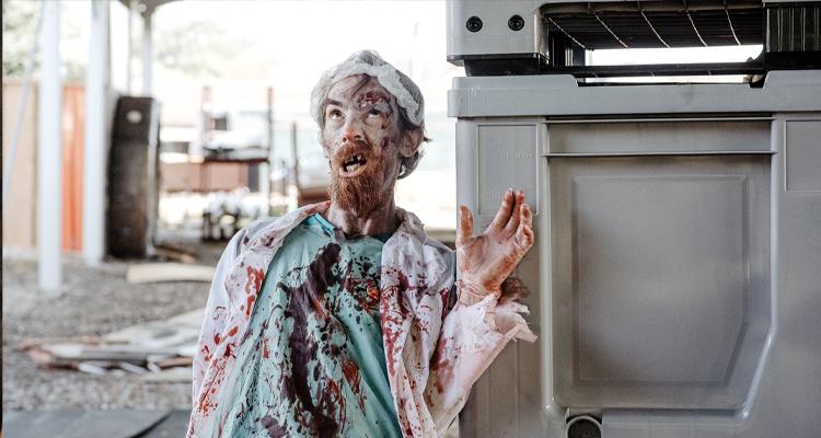 A zombified man in a doctor's uniform. Still from Zomblogalypse.